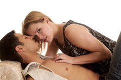 Woman on man laying her looking. A women is laying on a men and looking up Royalty Free Stock Photography