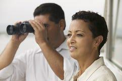 Woman With Man Looking Through Binoculars Royalty Free Stock Image