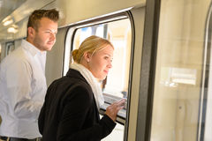 Woman and man looking out train window Royalty Free Stock Image