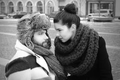 Woman and man looking in retro style city Royalty Free Stock Photos