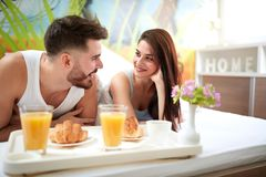 Woman and man in love at morning in bed stock images