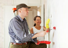 Woman and man making repairs at room Royalty Free Stock Image