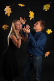 Woman and man and maple leaves Royalty Free Stock Photography