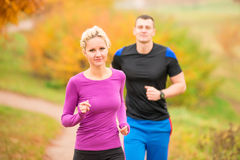 Woman and man on morning jog Royalty Free Stock Photo