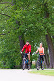 Woman and man on mountain bike in the woods Royalty Free Stock Photos