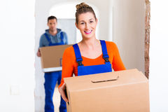 Woman and man moving in new home Royalty Free Stock Images