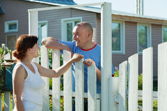 Woman and man near fence wicket Royalty Free Stock Photo