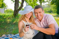 The woman and the man on picnic in park. Stock Photo