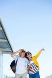 Woman with man pointing against clear sky Stock Images