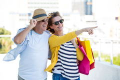 Woman with man pointing in city Royalty Free Stock Photography