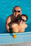 Woman and man at the pool board Stock Photography