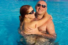 Woman and man at the pool board Stock Photo