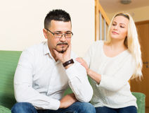 Woman with man after quarrel Stock Images