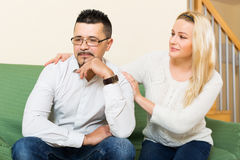 Woman with man after quarrel Royalty Free Stock Photo