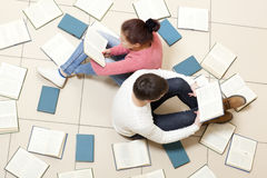 Woman and man reading book stock photography