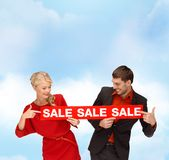 Woman and man with red sale sign Royalty Free Stock Photo