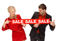Woman and man with red sale sign Stock Photos