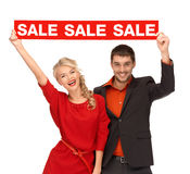Woman and man with red sale sign Stock Image