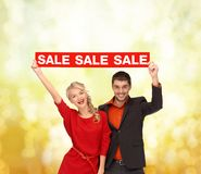 Woman and man with red sale sign Stock Images