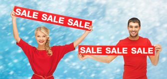 Woman and man with red sale signs Stock Photo