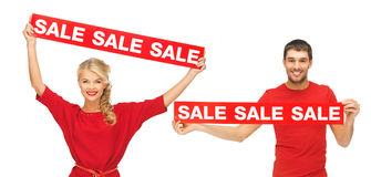 Woman and man with red sale signs. Shopping and christmas concept - women and men with red sale signs Royalty Free Stock Photos
