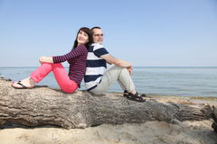 Woman and Man Relaxing on the Beach Royalty Free Stock Images