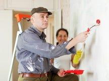 Woman and man repairs at home Royalty Free Stock Photo