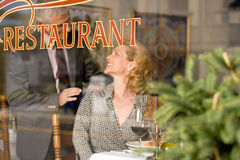 Woman and man in a restaurant Royalty Free Stock Photo