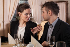 Woman and man in a restaurant Stock Images