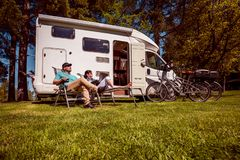 Woman with a man resting near motorhomes in nature. Family vacation travel, holiday trip in motorhome RV, Caravan car Vacation. stock photo