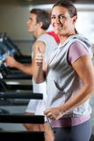 Woman And Man Running On Treadmill Royalty Free Stock Image