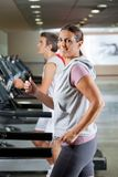 Woman And Man Running On Treadmill Royalty Free Stock Photo