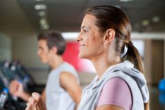 Woman And Man Running On Treadmill Stock Photography
