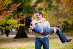 Woman in Man's Arms Royalty Free Stock Image