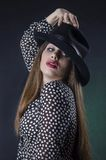 The woman with a man's hat. Royalty Free Stock Photos