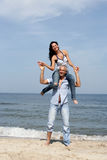 Woman on man's shoulders Royalty Free Stock Images