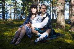 Woman and man in scottish costume Stock Images