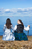 Woman and man in scottish costume near the sea Stock Image