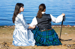 Woman and man in scottish costume near the sea Royalty Free Stock Images