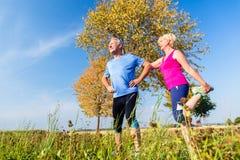 Woman and man, seniors, doing sport outdoors Stock Photo