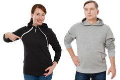 Woman and man set in sweatshirt front view. Guy and female in template clothes for print and copy space isolated on white. Woman and men set in sweatshirt front royalty free stock photo