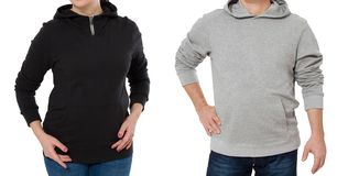 Woman and man set in sweatshirt front view. Guy and female in template hoody clothes for print and copy space isolated on white. Woman and men set in sweatshirt stock photography