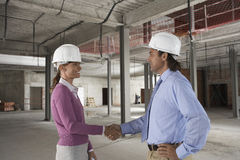 Woman And Man Shaking Hands At Site Royalty Free Stock Photos