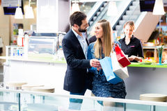 Woman and man shopping in mall Royalty Free Stock Image