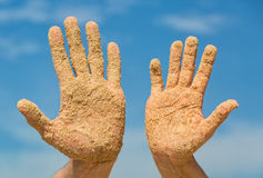 Woman and Man Shows his Open Hands Covered with Beach Sand Royalty Free Stock Image