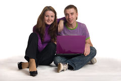 Woman and man sit with notebook. Stock Photography
