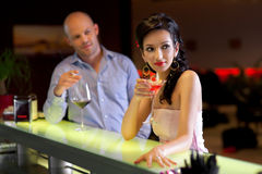Woman and man sitting by the bar Royalty Free Stock Photo