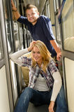 Woman and man sitting on train hall Stock Image