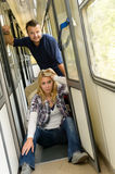 Woman and man sitting on train hallway Stock Photo