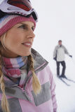 Woman With Man Skiing On Slope Stock Photos